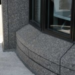 Granite base and wall cladding